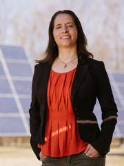Jennie Stephens, a professor of climate science and policy at University of Vermont, poses in front of solar panels in mid-March 2015.