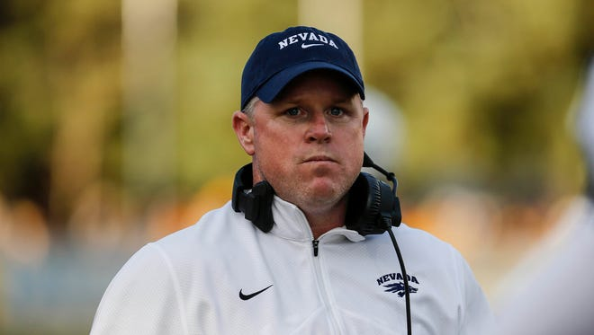 Nevada Wolf Pack head coach Brian Polian on the sidelines against the Wyoming Cowboys during the forth quarter at War Memorial Stadium. The Cowboys beat the Wolf Pack 28-21.