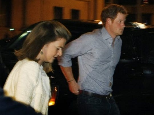 "Prince Harry steps out of a vehicle to eat at Rendezvous Thursday night in downtown Memphis. Prince Harry and Prince William are visiting Memphis for the Saturday wedding of former Memphian Elizabeth ""Lizzy"" Wilson and London nightclub owner Guy Pelly. (Karen Pulfer Focht/The Commercial Appeal)"