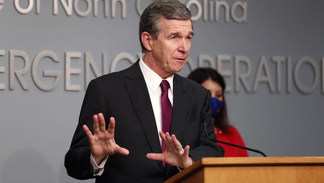 Gov. Roy Cooper answers a question during a briefing at the Emergency Operations Center in Raleigh Wednesday.