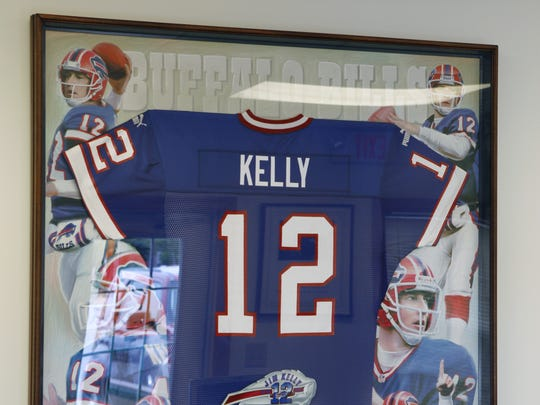 A framed jersey of Buffalo Bills legend Jim Kelly at his office in Williamsville.