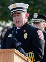 Green Bay Fire Chief David Litton speaks at a decommissioning