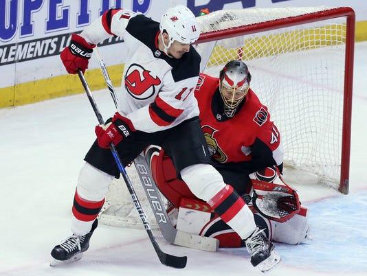 636535524916540808-Devils-Senators-Hockey-17683933.JPG