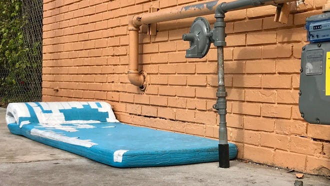 When the doors close at 4 p.m. at St. Ann Place in West Palm Beach, many homeless people have no choice but to sleep on the pavement. Others have to get creative to find comfort, like this outdoor air mattress.