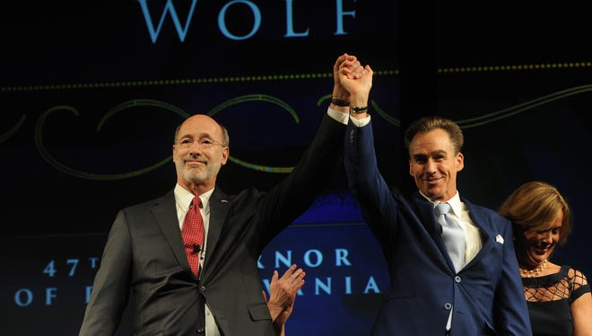 Pa. Gov. Tom Wolf celebrates with his Lt. Gov. Mike Stack at the inauguration ball at the Hershey Lodge in Hershey, Pa. on Tuesday, Jan. 20, 2015.