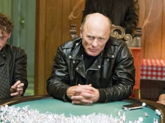 "The motorcycle gang (Anton Yelchin, Ed Harris and Milla Jovovich) of ""Cymbeline"" offer the insulting tribute of a mountain of Hershey's Kisses to the corrupt police rather than cash."