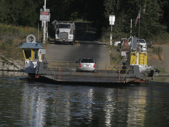 Morning commuters take the Wheatland Ferry across the