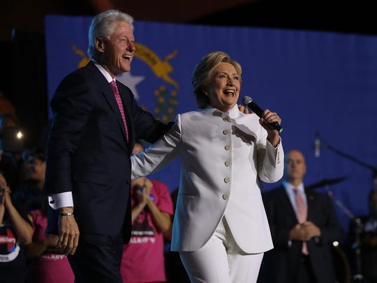 The Clintons speak during a debate watch party at Craig