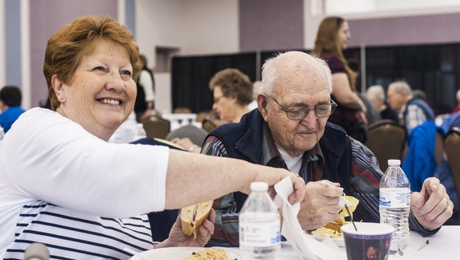 Betty and Stan DeZort eat at The Retired and Senior Volunteer Program's recognition lunch Monday. The DeZorts accumulated 4,010 hours over the course of 10 years.