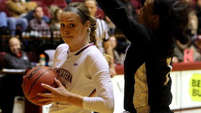 Midwestern State's Avery Queen works inside while guarded by Cameron's Charron Montgomery Tuesday, Jan. 17, 2017, in D.L. Ligon Coliseum at MSU. The Aggies defeated the Mustangs 94-76.