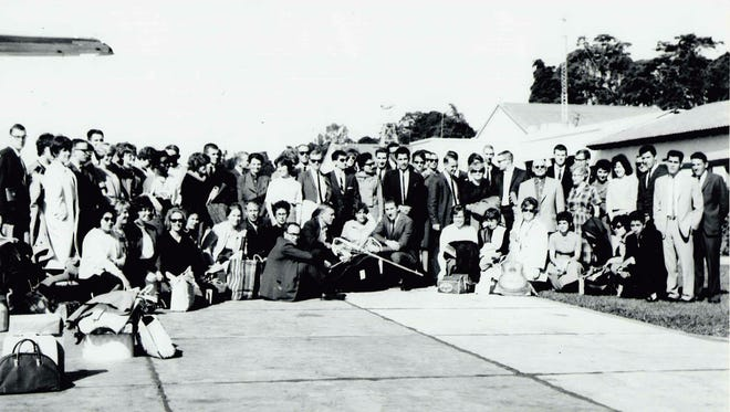 Peace Corps volunteers that trained at NMSU arrive at the Guatemala airport in 1963.