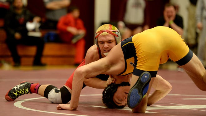 Richmond's Alston Bane and Shenandoah's Josh Gee compete for the sectional wrestling championship at 160 pounds Saturday, Jan. 30, 2016, at Tri High School in Lewisville.