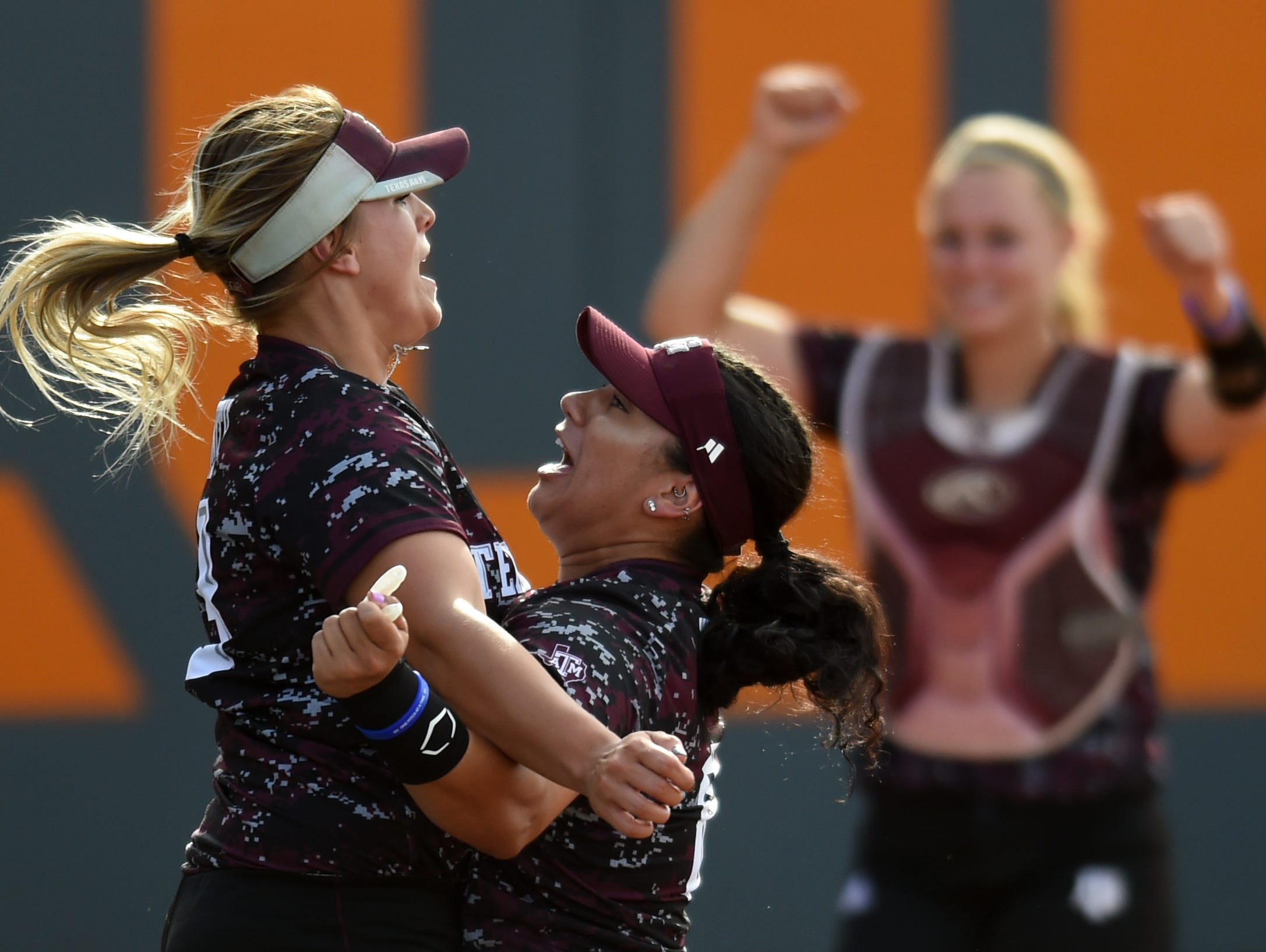 At left Texas A&M's Lexi Smith and Tori Vidales chest bump after winning an NCAA Super Regional game between Tennessee and Texas A&M at Sherri Parker Lee Stadium on Sunday, May 28, 2017. Texas A&M defeated Tennessee 5-3, and will head to Oklahoma City for the NCAA Women's College World Series.