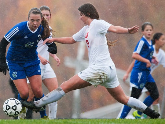 CVU's Catherine Cazayoux (9) battles for the ball with Colchester's Clara Johnson (3) during the girls soccer game between the Colchester Lakers and the Champlain Valley Union Redhwaks at CVU High School on Saturday morning October 17, 2015 in Hinesburg.