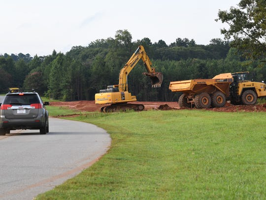 "Clemson RV Park at the Grove in Pendleton, a plot of land near the corner of state highway 187 and U.S. 76, is slated to be a place for recreational vehicles to park for camping or tailgating. ""You want to be all in,"" is written on the sign near construction equipment at work."