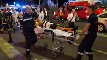 A wounded person is evacuated from the scene in Nice, France, on July 14, 2016.