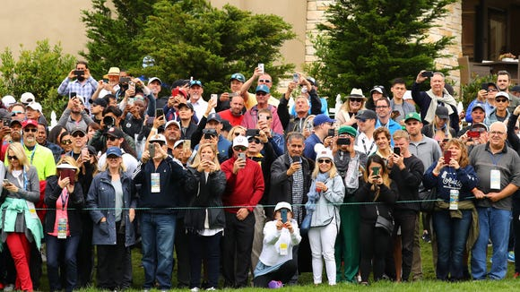 Golf fans watch Tiger Woods on the 1st hole during the final round of the 2019 U.S. Open. Photo: Rob Schumacher/USA TODAY Sports
