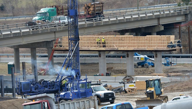December 2013 file photo of construction work on the Tinkling Spring Road bridge over Interstate 64.