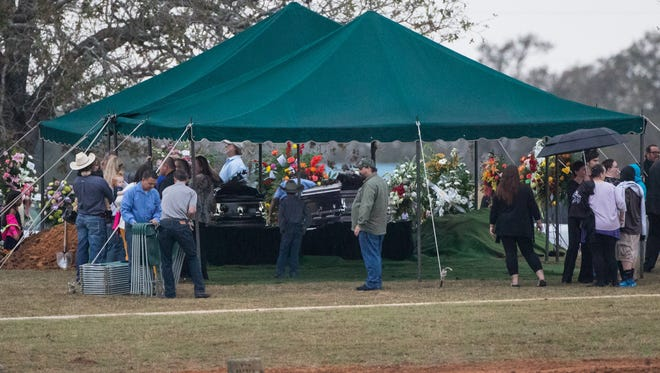 A young boy in a cowboy hat looks at the caskets of Richard and Therese Rodriguez during their burial at the Sutherland Springs cemetery on Saturday, Nov. 11, 2017. The Rodriguez where among the 25 killed in the  First Baptist Church shooting on Nov. 5, 2017.