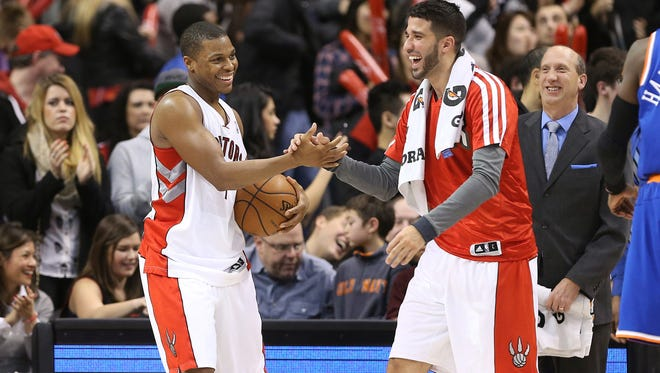 Toronto Raptors point guard Kyle Lowry (7) is congratulated by guard Greivis Vasquez (21) after defeating the New York Knicks at Air Canada Centre.