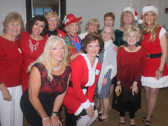 Ready to party are, back: MaryAnn Cassidy, Marge Superits, Polly Lally, Pat Zymros, Betsy Zinner, Pam Clune,  Cindy Crane and Susie Walsh; front: Rose Kraemer, Candy Seward, Becca Scarborough and Sharon Cook.