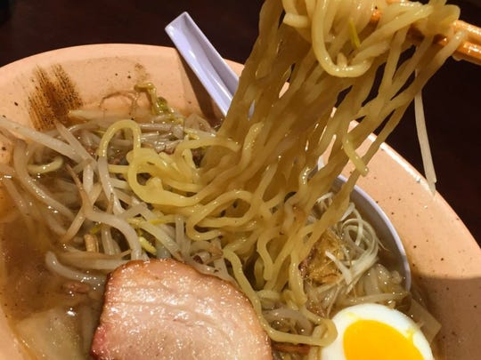 Roasted pork, a soft-boiled egg and slightly firm noodles in broth seasoned with salt at Ramen Ray.