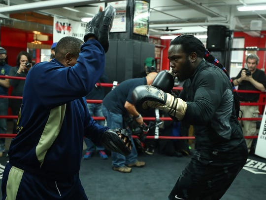 Bermane Stiverneworks the pads during a media workout on Wednesday.