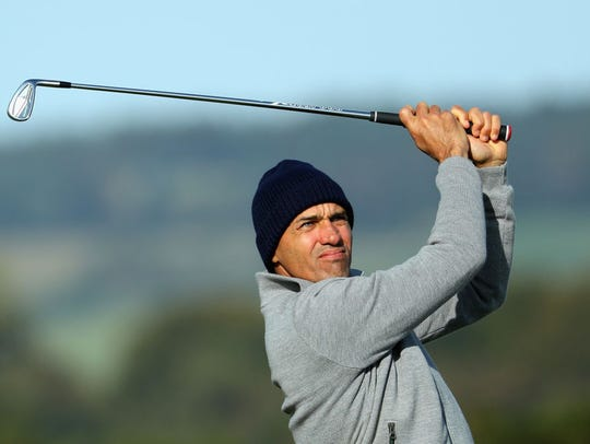 Kelly Slater plays his second shot on the 5th during