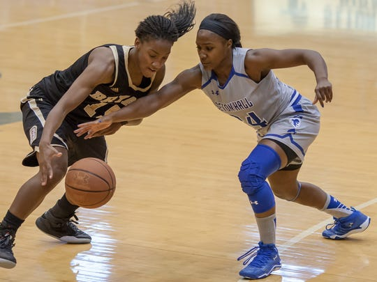 Seton Hall's Shakena Richardson (right)
