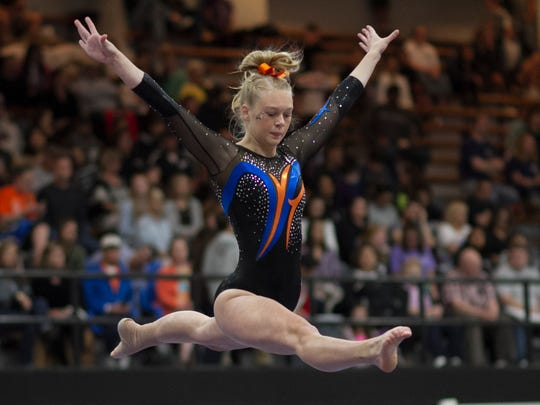 Skyler McCowen competes on the balance beam Saturday at the state gymnastics meet.