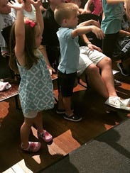 Learning to conduct: Brayden and Madeline Morieko for