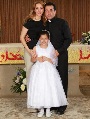 Deacon Wissam Akiki, right -- with his wife Manal Kassab and daughter Perla -- will be ordained as a priest this week at St. Raymond's Maronite Cathedral in St. Louis.