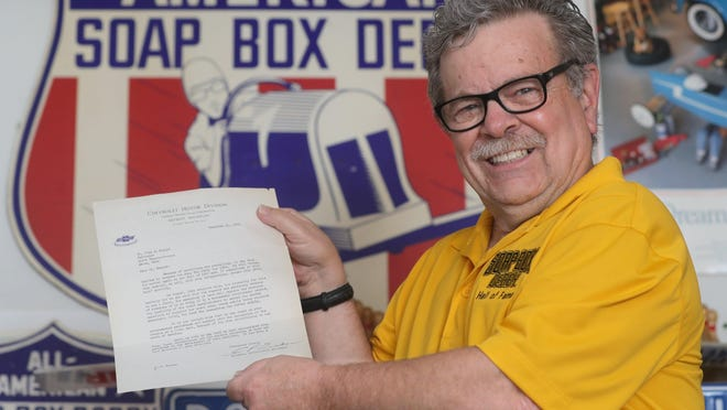 Jeff Iula holds the original 1941 Chevrolet letter to John S. Knight announcing the cancellation of the Soap Box Derby on Thursday, July 16, 2020, Cuyahoga Falls, Ohio.