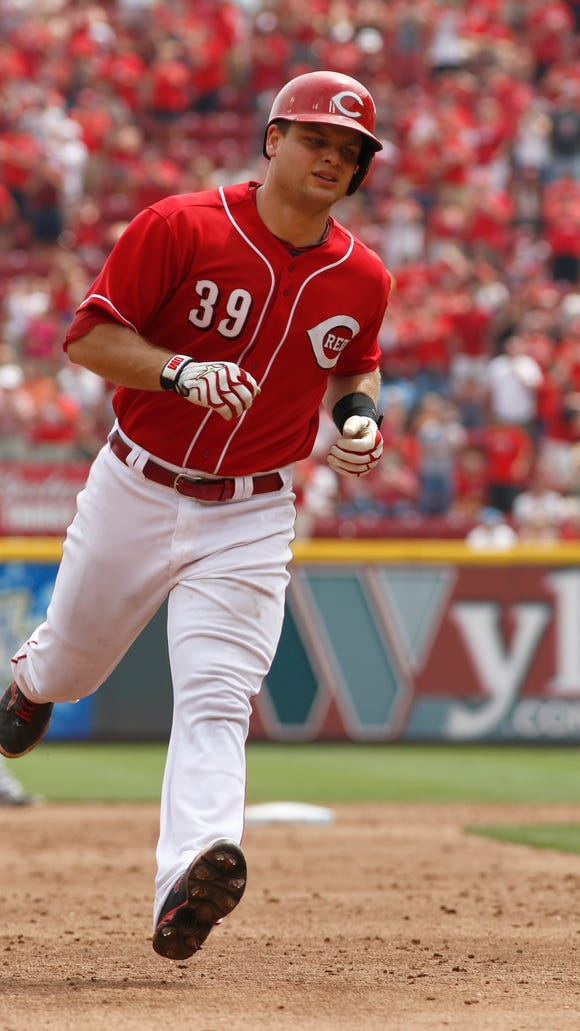 Cincinnati Reds'  Devin Mesoraco rounds the bases after hitting a grand slam off Miami Marlins starting pitcher Brad Hand in the fifth inning of a baseball game, Sunday.