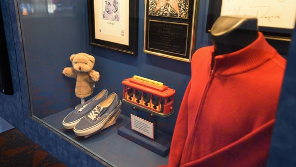 The exhibit includes a sweater, an original pair of