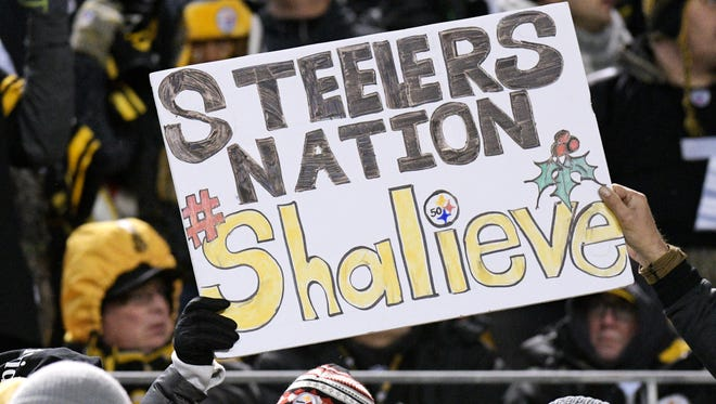 Pittsburgh Steelers fans hold a sign supporting injured Steelers linebacker Ryan Shazier during the second half of an NFL football game in Pittsburgh last month.