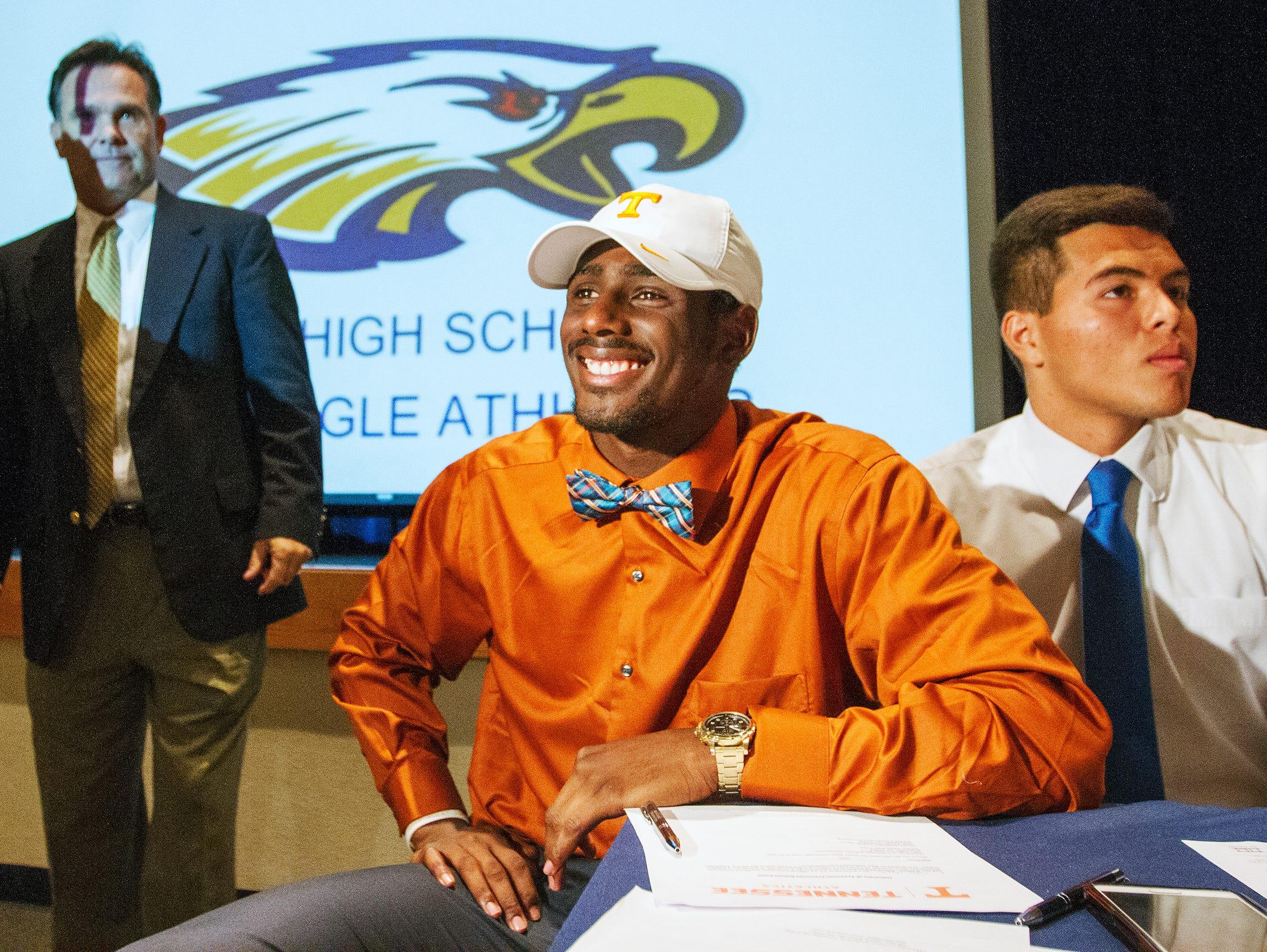 Naples High School football players Tyler Byrd, center, and Jerry Nunez, right, were among the school's athletes who signed National Letters of Intent Wednesday at the school. Byrd is going to the University of Tennessee and Nunez to Indiana State University. Head coach Bill Kramer is at left.