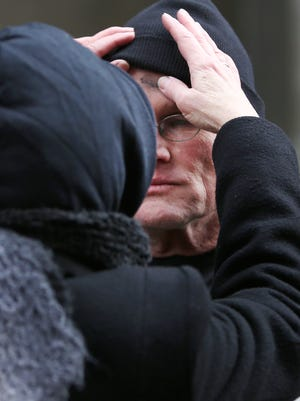 Paul Breidenbach, Hispanic Tenant Advocate for the fair-housing agency Housing Opportunities Made Equal, receives ashes on his forehead during the rally to mark the beginning of Lent.