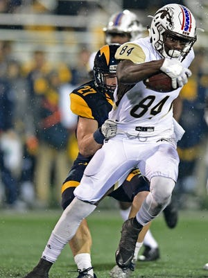 Western Michigan receiver Corey Davis (84) is grabbed by Kent State safety Kevin Bourne on Nov. 8, 2016, in Kent, Ohio.