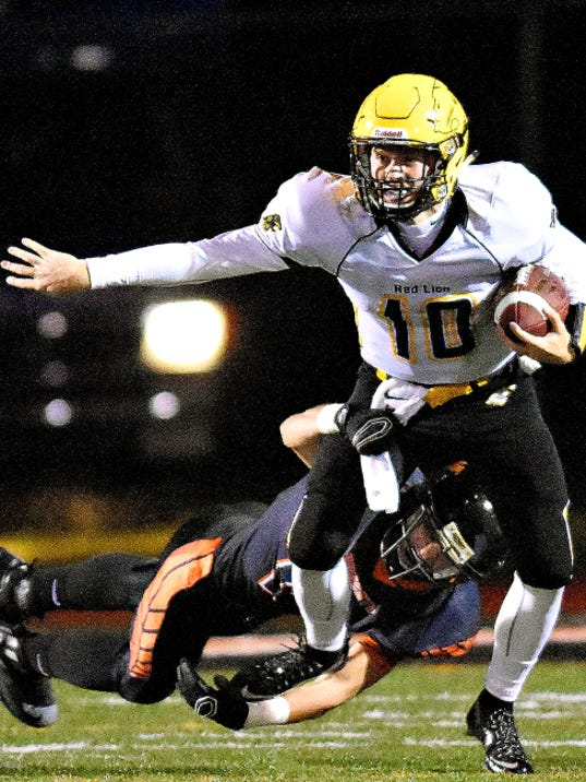 Red Lion's Dalton Grove, front, leaves behind Northeastern's Mason Kling during high school football action from earlier this season. Both Red Lion and Northeastern will be in District 3 playoff action on Friday night.