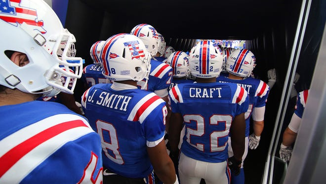 Louisiana Tech prepares to take the field during a rainy win last week over Middle Tennessee. Thunderstorms are expected tonight in Houston.