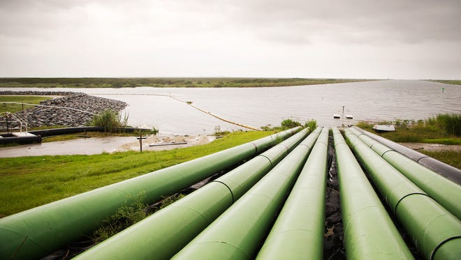 A series of pipes lays long the southern bank of Lake Okeechobee Thursday hours before the arrival of Hurricane Matthew.