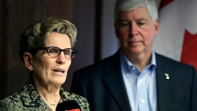 Ontario Premier Kathleen Wynne and Michigan Gov. Rick Snyder address the media Monday, March 13, 2017, in Detroit. Snyder and Wynne stressed that they want their voices heard as President Donald Trump demands a negotiation of trade policies between the United States, Mexico and Canada.