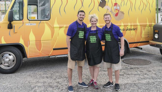 """Rogersville natives Justin, Shona and Landon House stand in front of their food truck, Stick 'Em Up. They will compete on the Food Network show """"The Great Food Truck Race: Battle for the South."""""""