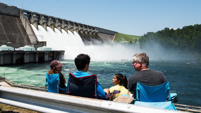 Chad Youngblood and Maleah, Hanan, and Mismeh Balawi watch as the gates at Hartwell Dam open for testing on Tuesday June 19, 2018.