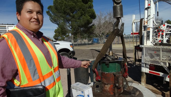 Fernando Ortiz, senior engineering technician for Las Cruces Utilities, stands next to the newly placed 7,000-pound water pump at Well 29. The new well is expected to go online and start producing water in February.