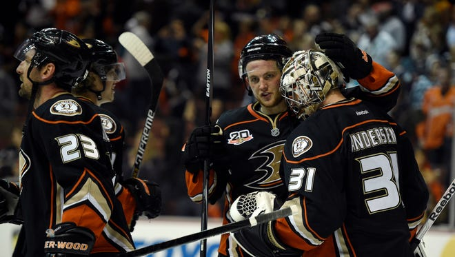 Anaheim Ducks goalie Frederik Andersen (31) celebrates with defenseman Cam Fowler (center) after the game against the Dallas Stars in game five of the first round of the 2014 Stanley Cup Playoffs at Honda Center.