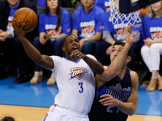Oklahoma City Thunder guard Dion Waiters (3) goes to the basket as Dallas Mavericks center Zaza Pachulia (27) defends during the first half of Game 1 of a first-round NBA basketball playoff series, Saturday, April 16, 2016, in Oklahoma City. (AP Photo/Alonzo Adams)