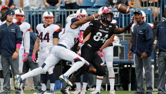 Cincinnati Bearcats wide receiver Nate Cole (84) makes the catch against Connecticut Huskies cornerback John Robinson IV (31) in the first quarter at Rentschler Field.