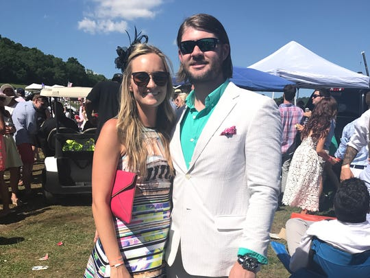 Mary Taylor Tepper and Ben Collier show off their coordinating looks with a fascinator and pocket square at the 76th annual Steeplechase.